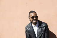 Portrait of a happy young man with sunglasses outdoors - IGGF00946