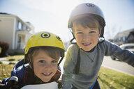 Portrait smiling brothers wearing helmets - HEROF34452