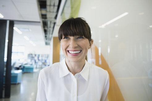 Portrait smiling businesswoman looking away - HEROF34470