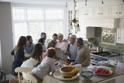 Multi-generation family surrounding kitchen island - HEROF34491