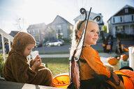 Kids in Halloween costumes on front stoop - HEROF34551