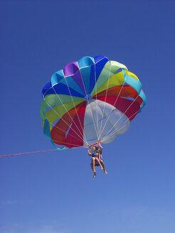 Two boys parasailing - WW04985