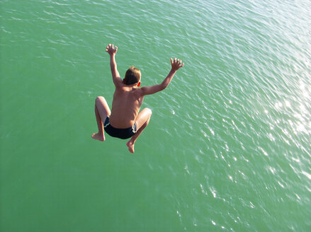 Boy jumping into water - WWF05014