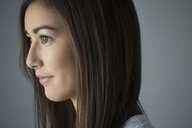 Close up pensive brunette young woman looking away - HEROF34873