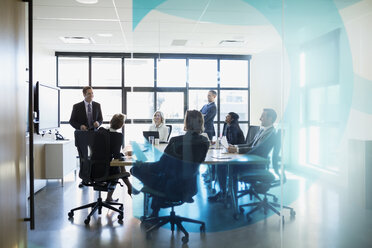 Businessman leading meeting in conference room - HEROF35023