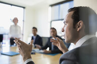 Close up businessman gesturing in conference room meeting - HEROF35026