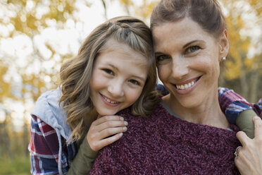 Close up portrait mother and daughter hugging outdoors - HEROF35074