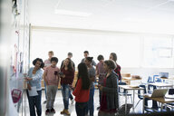 High school students watching teacher lesson at whiteboard - HEROF35182