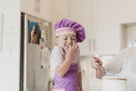 Happy, cute girl in chefÕs hat baking in kitchen - CAIF23067