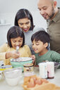 Family baking in kitchen - CAIF23121