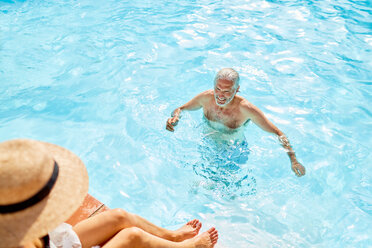 Mature man in sunny summer swimming pool - CAIF23160