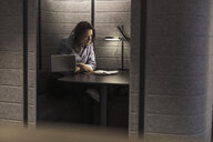 Businesswoman working with laptop and document in office niche - UUF17152