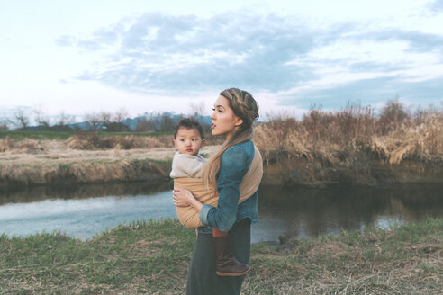 Mother holding her little daughter affectionately in nature - CMSF00059