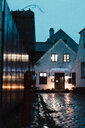 Denmark, Dragor, lighted house in the old town at twilight - AFVF02723