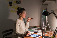 Woman working late at home - CUF49942