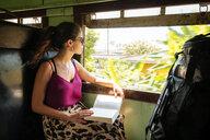 Woman on local train, Galle, South Coast, Sri Lanka - CUF49975