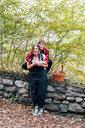 Women hugging, Rezzago, Lombardy, Italy - CUF50029