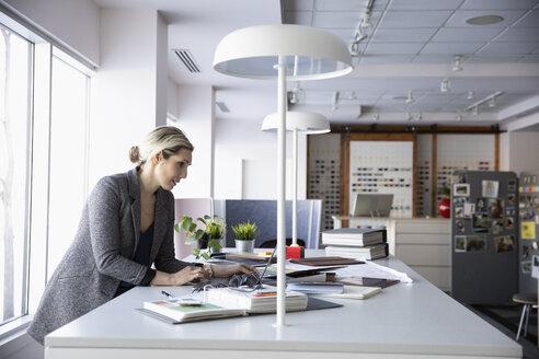 Female interior designer working in design studio - HEROF35439