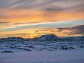 Iceland, snowy landscape surronding Krafla volcano and mountain in winter by sunrise - TAMF01271