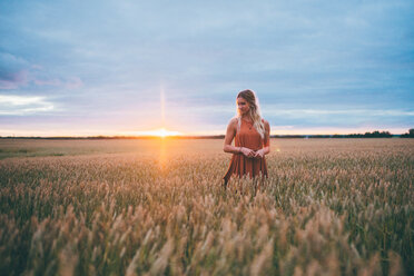 Woman enjoying wheat field, Edmonton, Canada - ISF21091