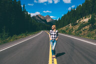 Woman in middle of road, Jasper, Canada - ISF21100