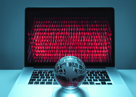 Globe illustrating the Americas on a laptop computer with screen been infected by a cyber attack - ABRF00360