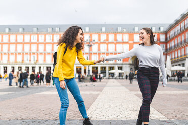 Girlfriends exploring city, Madrid, Spain - CUF50314