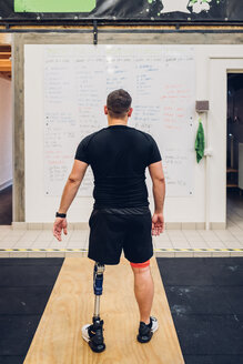 Man with prosthetic leg walking away - CUF50359