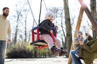 Happy family on playground - MAEF12840