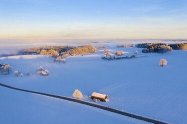 Germany, Bavaria, near Münsing, winter landscape at sunrise, aerial view - SIEF08562