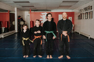 Coaches and students posing in martial arts studio - ISF21202