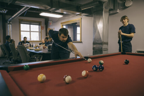 Firefighters playing pool in fire station - HEROF35575