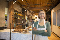 Portrait confident bakery owner - HEROF35620
