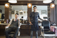 Portrait confident barbers in barber shop - HEROF35629