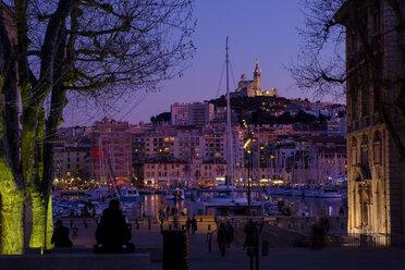 France, Marseille, old town, old harbour and Notre Dame de la Garde at dusk - LBF02562