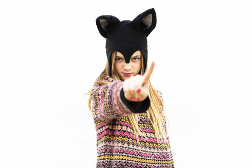 Portrait of girl posing in bat costume in front of white wall - ERRF00984