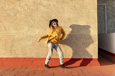 Portrait of girl singing and dancing on roof terrace - ERRF01014