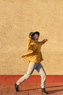 Happy girl dancing on root terrace - ERRF01017