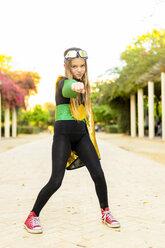 Portrait of girl posing in super heroine costume - ERRF01020