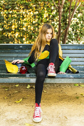 Girl in super heroine costume sitting on a bench - ERRF01026