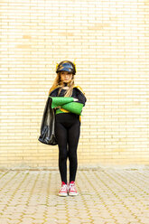 Girl in super heroine costume posing at brick wall - ERRF01029