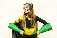 Girl in super heroine costume with band-aid on cheek - ERRF01047