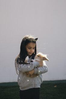Girl holding a bunny - MOMF00686