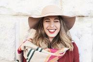 Portrait of a happy stylish woman wearing a floppy hat - IGGF01127