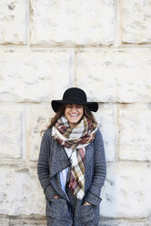 Portrait of a happy woman wearing a floppy hat - IGGF01130