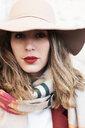 Portrait of a stylish woman wearing a floppy hat - IGGF01133