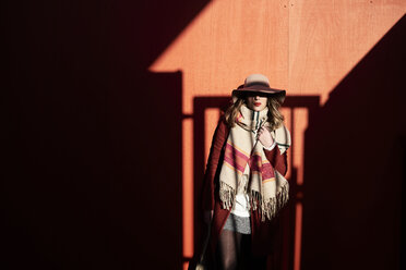 Stylish woman wearing a floppy hat in light and shadow - IGGF01148