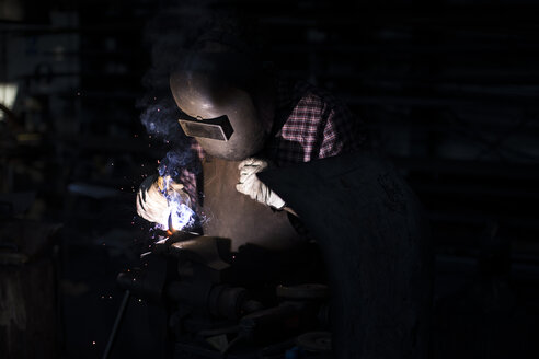 Man welding in his workshop - ABZF02314