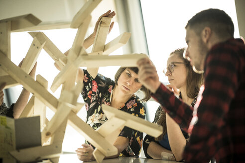 Group of creative professionals building wood object for a project - MJRF00157