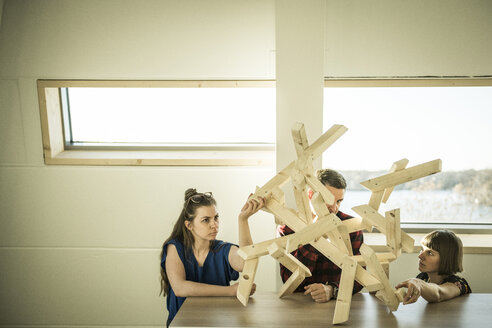 Group of creative professionals building wood object for a project - MJRF00187